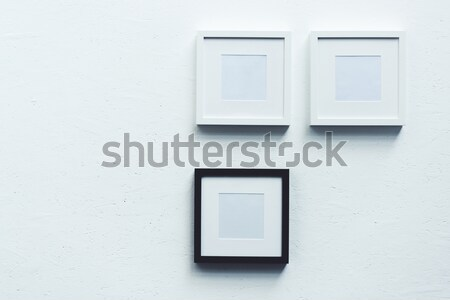 empty photo frame hanging on wall Stock photo © LightFieldStudios