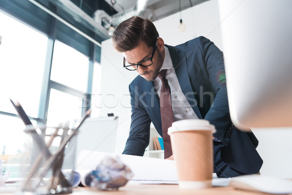 businessman working with papers  Stock photo © LightFieldStudios