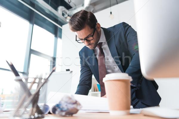 бизнесмен рабочих документы серьезный молодые очки Сток-фото © LightFieldStudios
