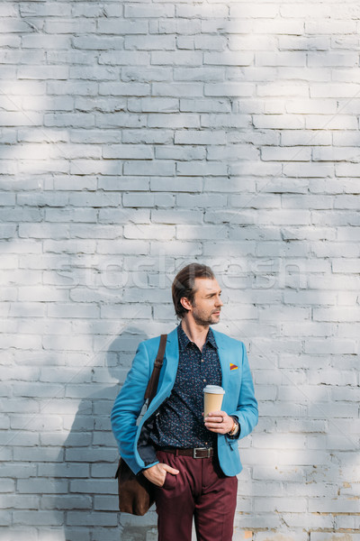 stylish man with coffee to go Stock photo © LightFieldStudios