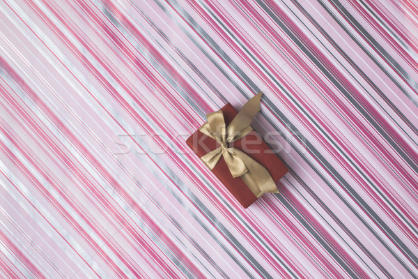 christmas gift on wrapping paper Stock photo © LightFieldStudios