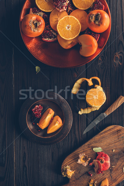 top view of fruits and cutting board with knife on table Stock photo © LightFieldStudios