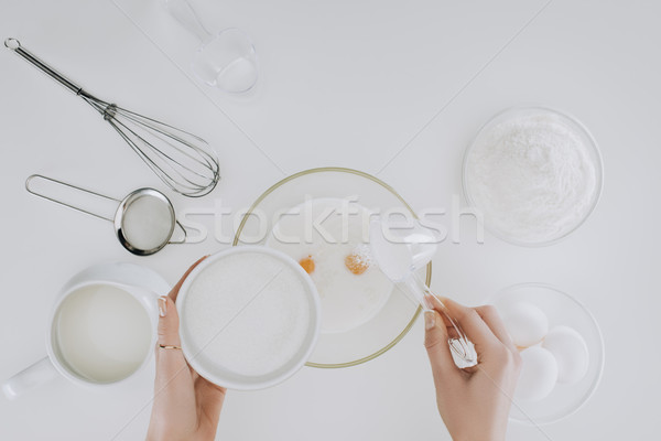 top view of person cooking pancakes isolated on grey Stock photo © LightFieldStudios