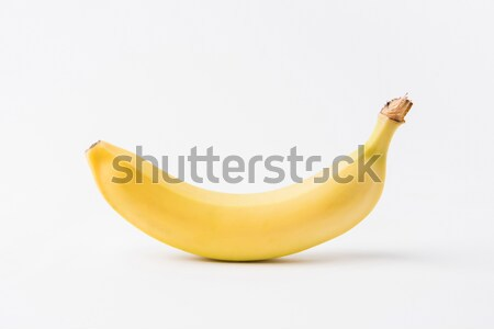 raw unpeeled banana laying on white background   Stock photo © LightFieldStudios