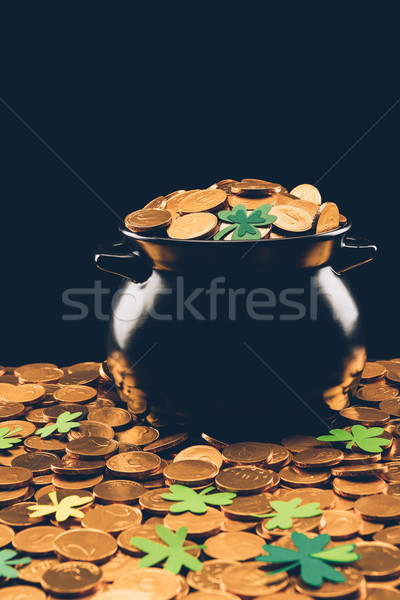 Stock photo: black pot with golden coins isolated on black, st patricks day concept