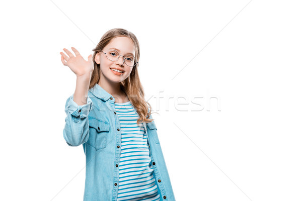 cute teenage girl waving hand and smiling at camera isolated on white Stock photo © LightFieldStudios