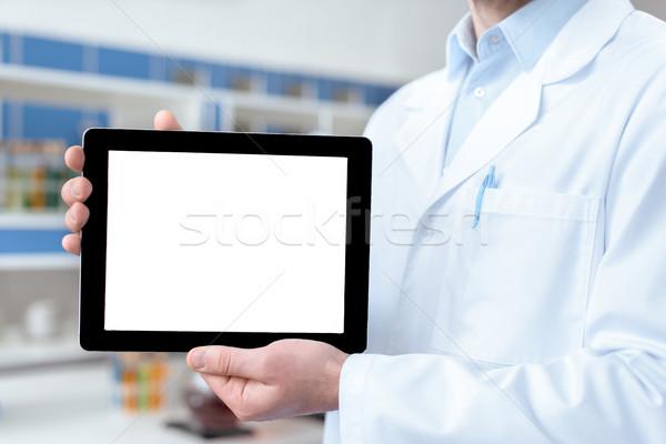 Ver médico jaleco digital Foto stock © LightFieldStudios