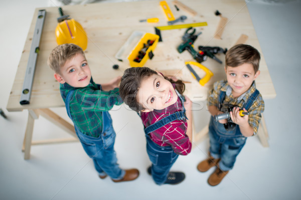 Happy kids with tools Stock photo © LightFieldStudios
