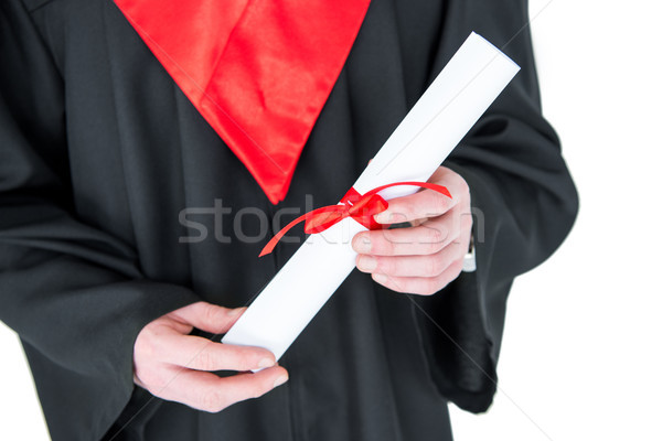 Close-up partial view of young man in graduation gown holding diploma on white Stock photo © LightFieldStudios