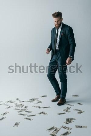 Stijlvol zakenman permanente dollar bankbiljetten vloer Stockfoto © LightFieldStudios
