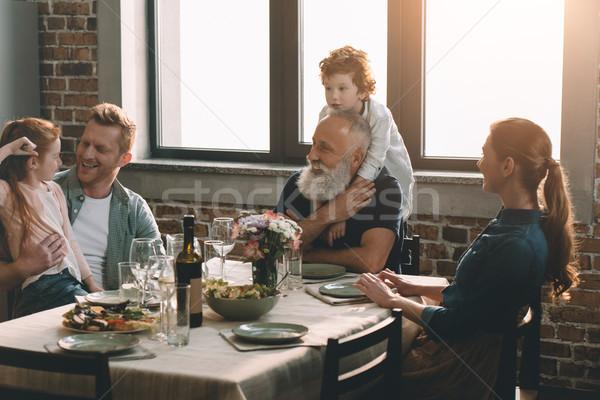 Kicsi fiú ölel nagyapa család vacsora Stock fotó © LightFieldStudios