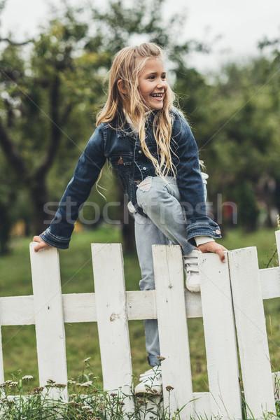 child climbing over the fence Stock photo © LightFieldStudios