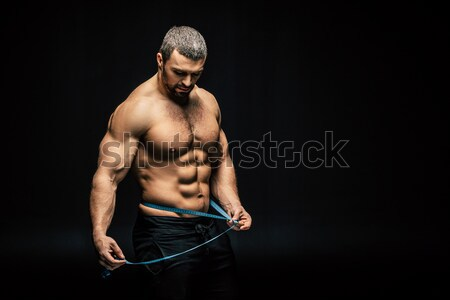 sportive man with measuring tape Stock photo © LightFieldStudios