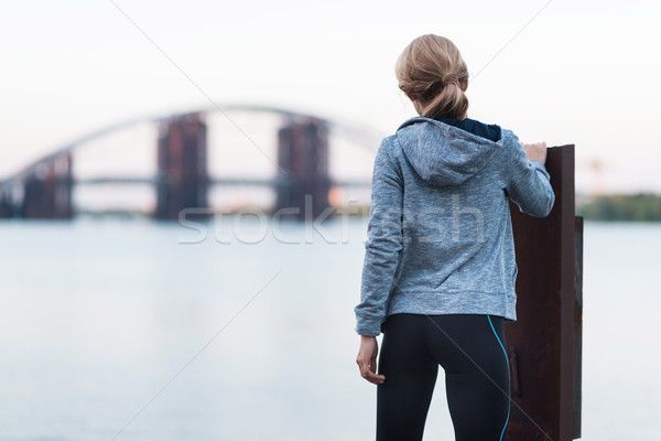 sportswoman standing on quay Stock photo © LightFieldStudios