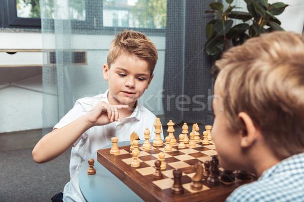 Piccolo ragazzi giocare scacchi cute Foto d'archivio © LightFieldStudios