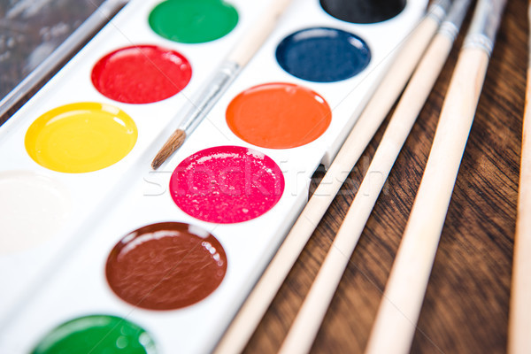 Watercolor paints and paintbrushes Stock photo © LightFieldStudios
