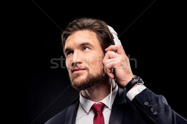 красивый бизнесмен наушники портрет белый улыбаясь Сток-фото © LightFieldStudios
