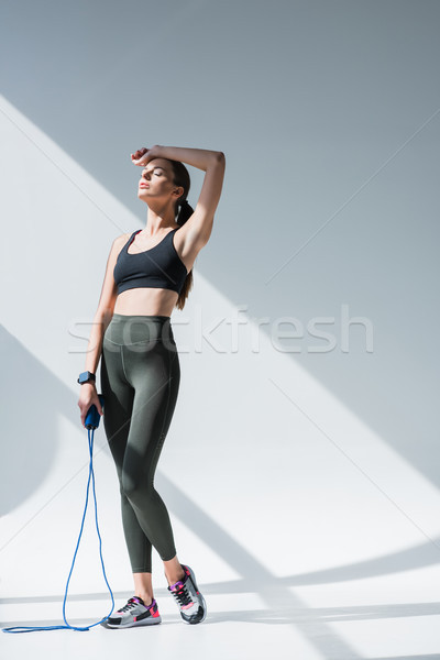 athletic girl with skipping rope Stock photo © LightFieldStudios