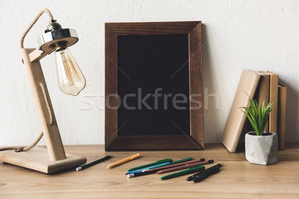 Fényképkeret irodaszerek asztal közelkép kilátás üres Stock fotó © LightFieldStudios