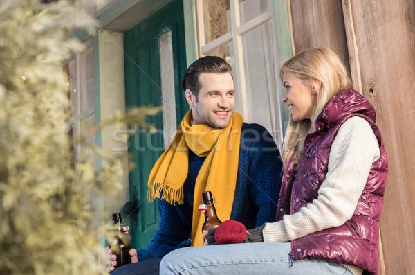 Boldog fiatal pér iszik sör néz egyéb Stock fotó © LightFieldStudios