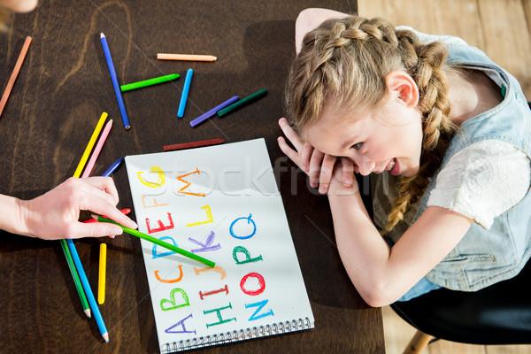счастливым матери дочь рисунок обучения алфавит Сток-фото © LightFieldStudios