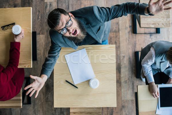 üzletember kiált kamera felső kilátás felemelt kezek Stock fotó © LightFieldStudios