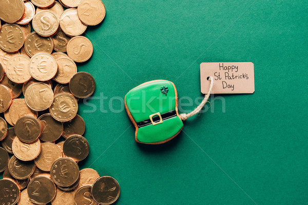 top view of gingerbread and golden coins on green, st patricks day concept Stock photo © LightFieldStudios