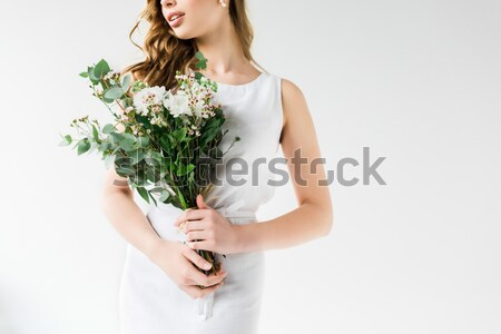 Stock photo: beautiful bride sniffing wedding bouquet, isolated on white