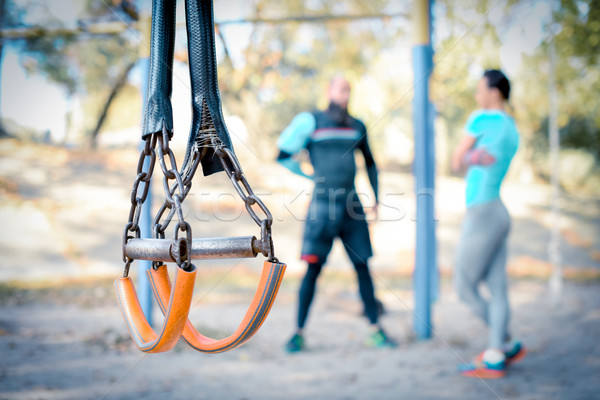 Couple working out with sport equipment on foreground Stock photo © LightFieldStudios