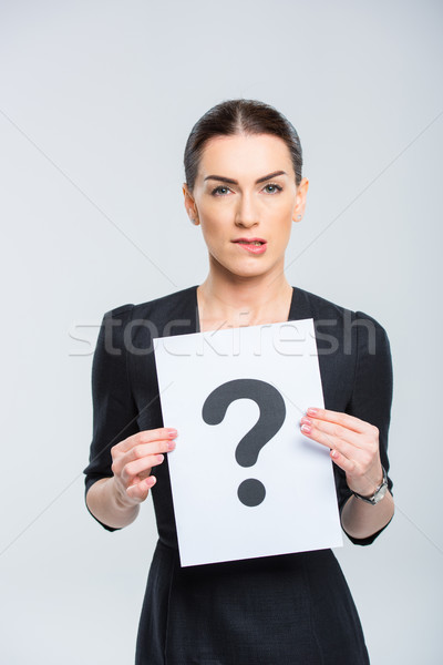 Woman holding card with question mark Stock photo © LightFieldStudios