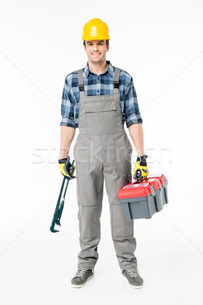 Workman holding tool kit Stock photo © LightFieldStudios