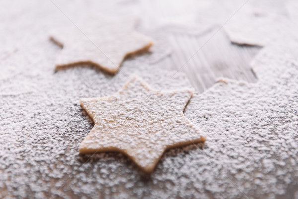 'Close-up view of unbaked star shaped cookies in flour on table  Stock photo © LightFieldStudios