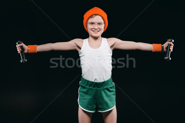 boy training with dumbbells isolated on black. athletics children concept Stock photo © LightFieldStudios