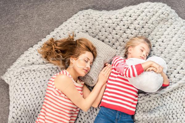 Mother and daughter sleeping Stock photo © LightFieldStudios