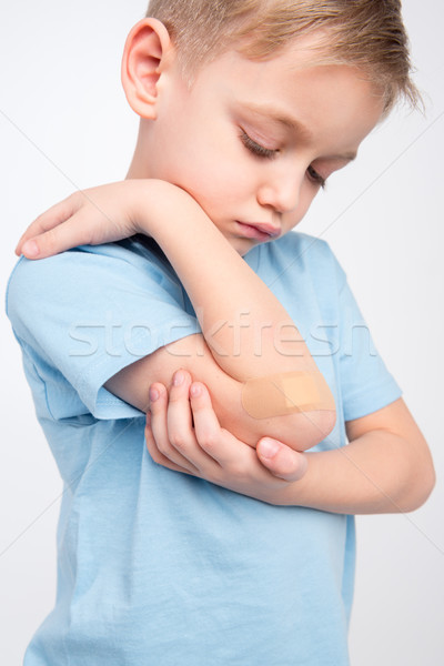 Pequeno menino cotovelo triste olhando Foto stock © LightFieldStudios