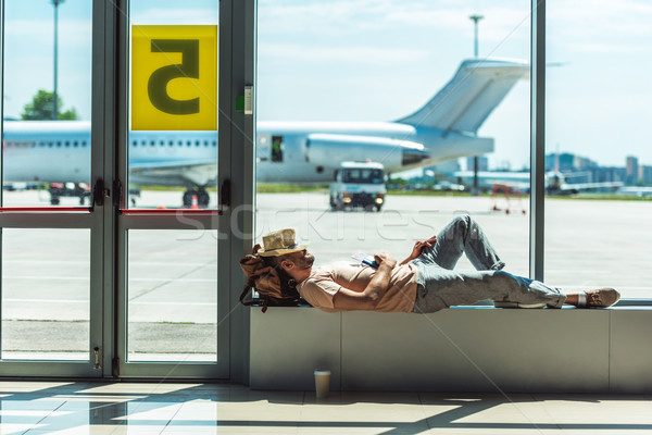 traveler sleeping in airport Stock photo © LightFieldStudios