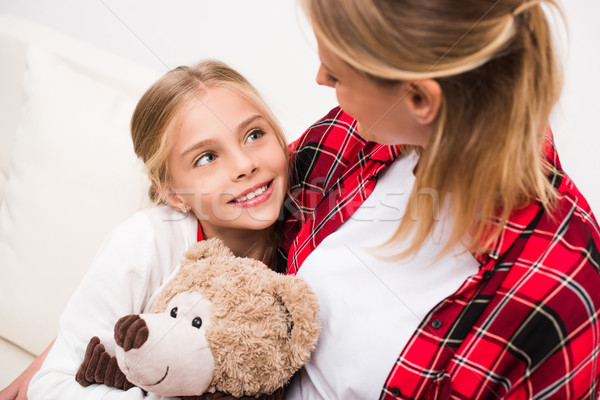 mother and daughter with teddy bear  Stock photo © LightFieldStudios