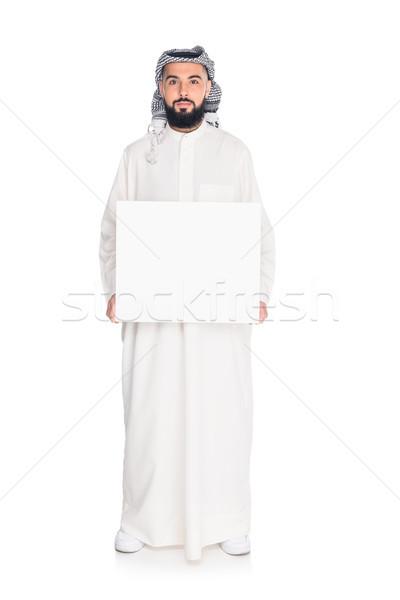 Muszlim férfi tart tábla jóképű izolált Stock fotó © LightFieldStudios