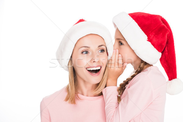 daughter whispering to mother on christmas Stock photo © LightFieldStudios