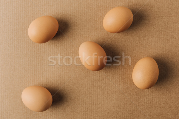 brown eggs scattered on brown carton  Stock photo © LightFieldStudios