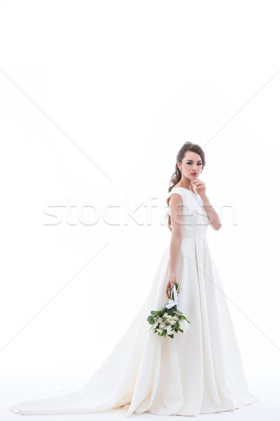 attractive bride posing in traditional white dress with wedding bouquet, isolated on white Stock photo © LightFieldStudios