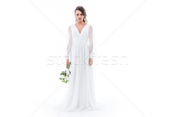 caucasian bride posing in elegant white dress with wedding bouquet, isolated on white Stock photo © LightFieldStudios