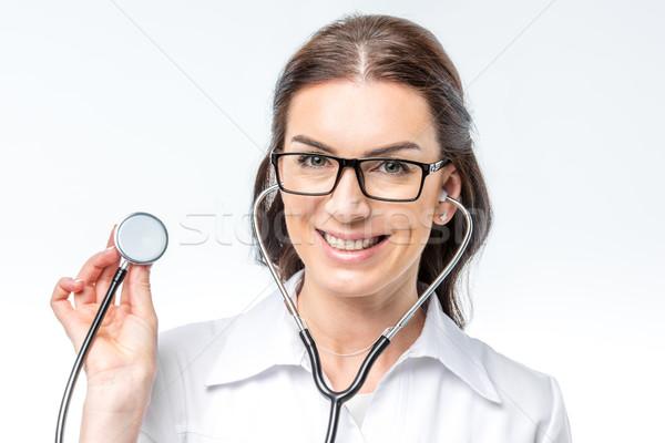 女性 医師 聴診器 美しい 笑みを浮かべて カメラ ストックフォト © LightFieldStudios