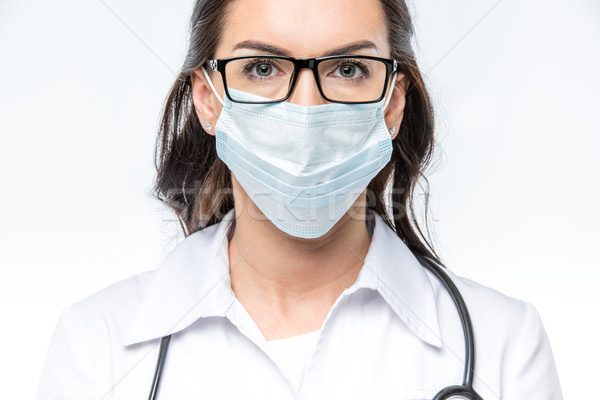 Doctor in medical mask Stock photo © LightFieldStudios