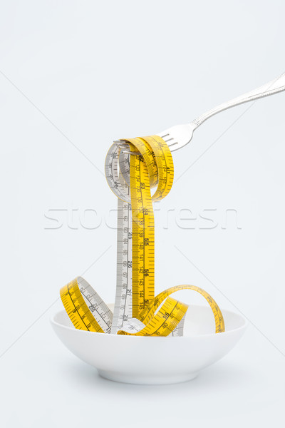 measuring tape on fork isolated on white, healthy living concept Stock photo © LightFieldStudios