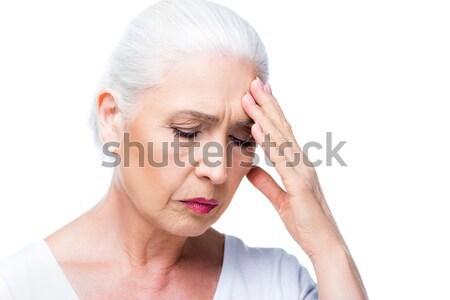 tired senior woman with headache Stock photo © LightFieldStudios