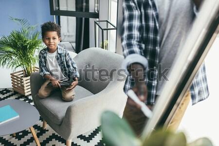 Férfi gitár új ház jóképű fiatalember játszik Stock fotó © LightFieldStudios