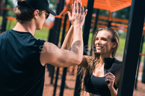 woman giving high five to trainer Stock photo © LightFieldStudios