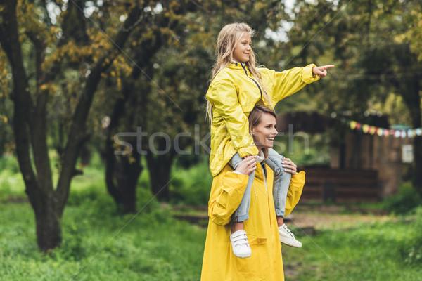 Anya lánygyermek boldog áll citromsárga természet Stock fotó © LightFieldStudios