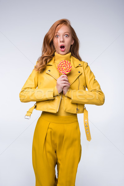 shocked girl in leather jacket with lollipop Stock photo © LightFieldStudios